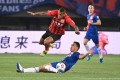 The two Shanghai clubs played a out a draw in their Chinese Super League derby clash. Photo: Xinhua
