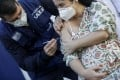 A pregnant woman gets vaccinated against Covid-19 in Rio de Janeiro, Brazil. Photo: Reuters