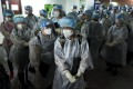Medical workers arriving last week at a building in Tsuen Wan linked to a mutated coronavirus infection. Photo: Edmond So
