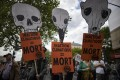 Protesters take part in a demonstration against global warming in Paris, France on Sunday, with placards reading 'Climate inaction = death'. Photo: EPA-EFE