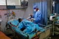 A medical worker tends to a patient at Safdarjung Hospital in New Delhi. Photo: Reuters