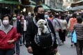 Taiwan has reintroduced mask rules as it tries to limit the spread of the coronavirus. Photo: AP