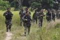 Malaysian soldiers seen on patrol during an operation in Sabah state. Photo: Handout via EPA