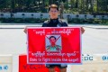 Phoe Thaw holds up a sign challenging Myanmar army general Min Aung Hlaing to a fight. Photo: Twitter