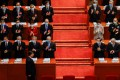 Hong Kong Chief Executive Carrie Lam Cheng Yuet-ngor and Chinese officials applaud as President Xi Jinping arrives for the opening session of the National People's Congress at the Great Hall of the People in Beijing on March 5. Photo: Reuters
