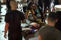 Television footage shows an Israeli mob attacking a person they considered an Arab man on the seafront promenade of Bat Yam, a town south of Israel's commercial capital Tel Aviv. Photo: Kan 11 public broadcaster via AFP