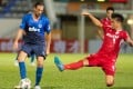 Kitchee's Dejan Damjanovic tries to escape the attentions of Southern's Kota Kawase in the final game of the 2020-21 Hong Kong Premier League regular season. Photo: HKFA