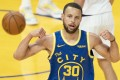 Golden State Warriors guard Stephen Curry celebrates after making a basket against the Phoenix Suns. Photo: Kyle Terada-USA Today Sports
