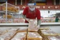 A worker restocks chicken in the meat product section at a grocery store in Dallas, US, on April 29. Rising prices for a variety of commodities are contributing to a jump in prices, with Americans paying more for meat, petrol, items they keep in their homes and even the homes themselves. Photo: AP