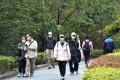 People wearing face masks walk on a street in Hong Kong. Photo: Xinhua