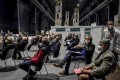 People wait to get their dose of Covid-19 vaccine in Milan, Italy. File photo: LaPresse via AP