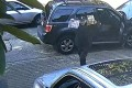 A man blocks the car of an employee of the Chinese consulate in Vancouver, British Columbia, on March 22. The suspect then spit on the employee's car and berated him, police said. Photo: VPD