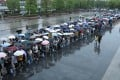 People line up in the rain to get vaccinated against the coronavirus in Fuyang, Anhui province, over the weekend. Photo: Reuters