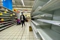 Shoppers check almost empty shelves as they rush to buy grocery essentials in a supermarket in Taipei on May 17. Photo: EPA-EFE