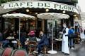 People sit at the terrace of Paris' landmark Cafe de Flore on Wednesday. Photo: AFP