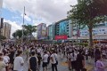 A photo posted on Chinese social media shows people in the street after they ran out of the SEG Plaza on Tuesday. The city's government has said the structure is safe. Photo: Handout