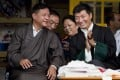 Penpa Tsering, left, talks to his predecessor as leader of the Tibetan government-in-exile Lobsang Sangay, right, in Dharamsala, India, in 2013. Photo: AP