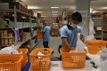 Staff preparing food deliveries at the Penny's Bay quarantine centre on Hong Kong's Lantau Island. Photo: Dickson Lee