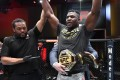 Francis Ngannou celebrates with the heavyweight title after beating Stipe Miocic at UFC 260. Photos: USA Today Sports
