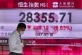 A bank's electronic board showing the Hong Kong share index at Hong Kong stock exchange Thursday, May 20, 2021. Photo: AP