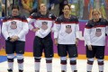 Ice hockey player Julie Chu (second right) with United States team members after missing out on a gold medal against Canada at the Sochi Games in 2014. Photo: Reuters