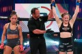 Hannah Guy's arm is raised after earning a unanimous decision against Valerie Loureda at Bellator 259. Photos: Bellator MMA