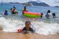People play in the sea at Repulse Bay on Sunday. Photo: Sam Tsang