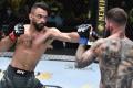 Rob Font punches Cody Garbrandt in their bantamweight bout at UFC Vegas 27. Photos: Chris Unger/Zuffa LLC