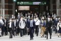 Commuters head out of Tokyo Station on May 6. In Asia, surveys conducted last year showed that most workers missed the social interaction that office life brings. Photo: Kyodo
