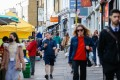 Pedestrians along Portobello Road in the Notting Hill district of London on Wednesday, May 12, 2021. Photo: Bloomberg