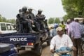 Mali police are seen outside the Bourse du Travail, where striking workers gathered to protest the arrest of President Bah N'Daw and Prime Minister Moctar Ouane in Bamako on Tuesday. Photo: AP