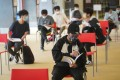 Hong Kong students wait to write a DSE core subject exam at a school in San Po Kong on April 27. Photo: Winson Wong