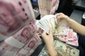 Analysts have predicted that the yuan should continue to strengthen this year against the US dollar. Photo: EPA-EFE