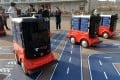JD.com's driverless delivery vehicles during a test operation at the Sino-Singapore Tianjin Eco-City in Tianjin on January 18, 2018. Photo: AFP.