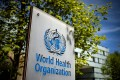 A sign of the World Health Organization is seen outside its headquarters in Geneva. Photo: AFP