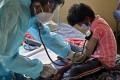 A doctor checks the blood pressure of a child at a Covid-19 care centre in Bangalore, India. Photo: Sopa Images via Zuma Wire/DPA