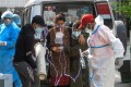 A Covid-19 patient breathes with the help of medical oxygen as she arrives outside an emergency ward at the Sukraraj Tropical and Infectious Disease Hospital in Kathmandu, Nepal, on May 13. Photo: AFP