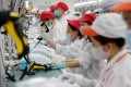 Workers at a factory line in Hanoi. File photo: Reuters