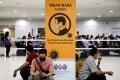 People wait to receive a Covid-19 vaccine at a vaccination centre in Kuala Lumpur, Malaysia. Photo: Reuters