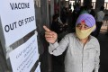 A man points to notices displayed in a hospital indicating that coronavirus vaccines are out of stock, in Amritsar, India, on May 17. Photo: AFP