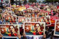 Protesters hold portraits of Myanmar's ousted civilian leader Aung San Suu Kyi during a protest against the military coup. File photo