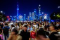 Crowds throng the Bund, Shanghai's iconic promenade along the Huangpu river, against the dazzling backdrop of the Lujiazui financial district of Pudong on the other bank. Photo: Reuters