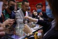 An attendant pours samples of Kweichow Moutai for guests at the China Food and Drinks fair in Chengdu, Sichuan province in April 2021. Photo: AFP