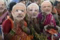 BJP supporters wear a mask of PM Narendra Modi at a rally in Hyderabad. File photo: AFP
