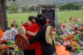 People from Mosakahiken Cree Nation at a makeshift memorial at the former Kamloops Indian Residential School. Photo: AFP
