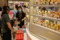 A girl looks at blind boxes in a Pop Mart store in a shopping centre in Beijing on June 3. The toymaker caused a firestorm on social media this week when it was revealed that it had asked female job applicants about their plans to have children, for which the company apologised. Photo: EPA-EFE