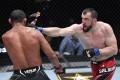 Muslim Salikhov punches Francisco Trinaldo in their welterweight fight at UFC Vegas 28. Photos: Jeff Bottari/Zuffa LLC