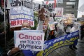 Protesters in Tokyo shout slogans during a rally on Sunday against the Olympic Games. Photo: EPA