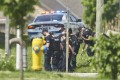 Police investigate at the scene of a car crash in London, Ontario, on Monday. Photo: The Canadian Press via AP