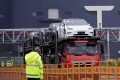A truck transports new Tesla cars at its factory in Shanghai. Photo: Reuters.